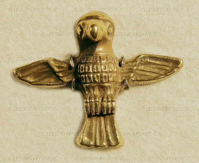 """The holy bird of Artemis"". Hawk with streched wings. Gold clasp (1st half of 6th BCE) from the foundations of the temple of Artemis Ephesus, Turkey Height 2.6 cm - weight 45 g"