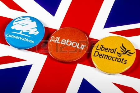 77203911-london-uk--may-2nd-2017-conservatives-labour-and-liberal-democrat-pin-badges-over-the-uk-flag-symbol