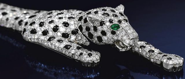 The-Duchess-of-Windsors-Cartier-panther-bracelet.-The-fully-articulated-piece-is-pavé-set-with-brilliant-and-single-cut-diamonds-and-calibré-cut-onyx.-It-was-made-by-Cartier-in-1952.